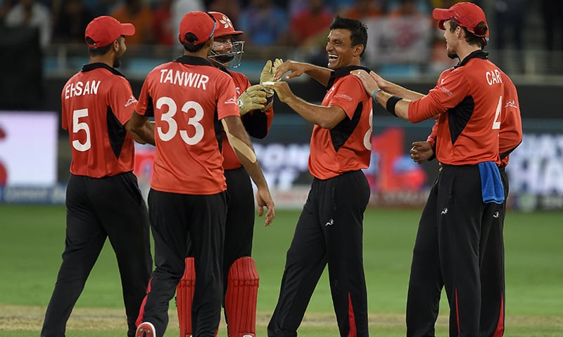Hong Kong cricketer Ehsan Khan (C) celebrates with teammates after dismissing Indian batsman Mahendra Singh Dhoni (unseen) during the one day international (ODI) Asia Cup cricket match between Hong Kong and India at the Dubai International Cricket Stadium. —AFP