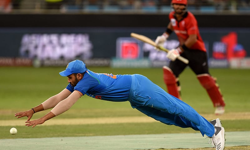 Indian cricket team captain Rohit Sharma dives for the ball. —AFP