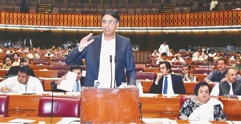 ISLAMABAD: Federal Minister for Finance, Revenue and Economic Affairs Asad Umar presents the Finance Supplementary (Amendment) Bill, 2018, in the National Assembly on Tuesday.—INP