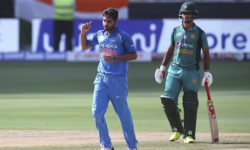 India's Bhuvneshwar Kumar, left, celebrates the dismissal of Pakistan's Imam-ul-Haq. — AP