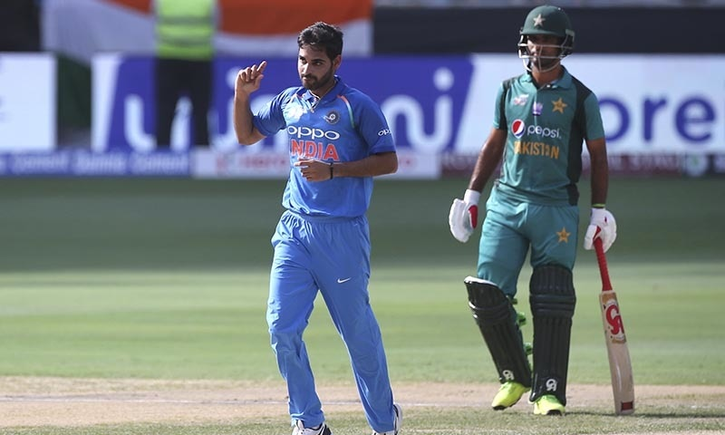 India's Bhuvneshwar Kumar, left, celebrates the dismissal of Pakistan's Imam-ul-Haq. — AP