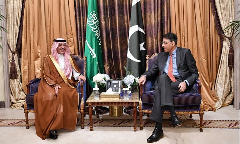 Finance Minister Asad Umar meets Saudi Minister of Finance. — Photo courtesy: *Arab News* Twitter