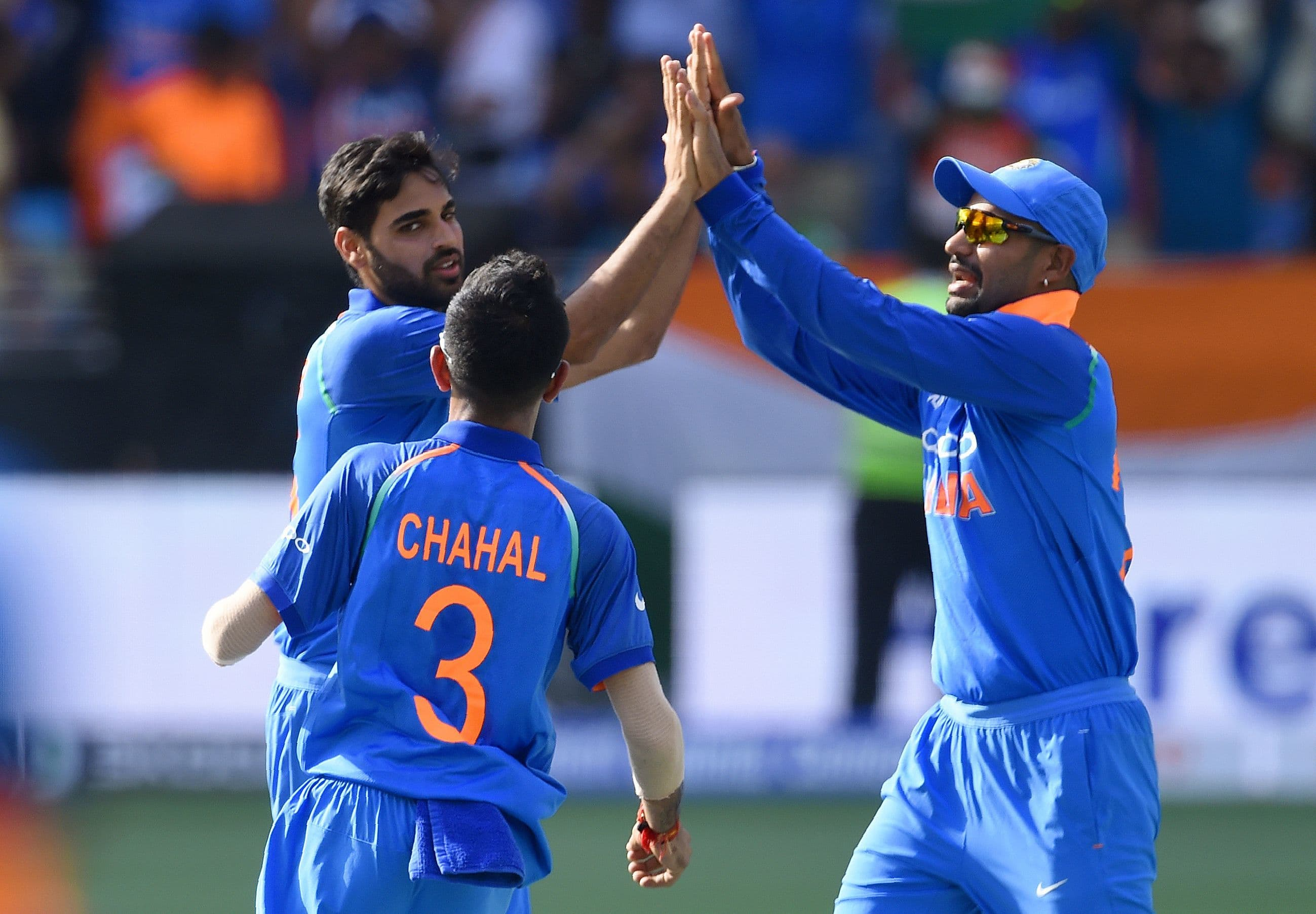 Indian cricketer Bhuvneshwar Kumar (L) celebrates with teammates after he dismissed Pakistan batsman Imam-ul-Haq. —AFP