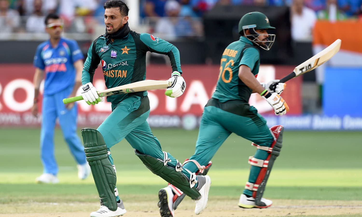 Pakistan batsman Shoaib Malik (L) and Babar Azam run between the wickets. — AFP