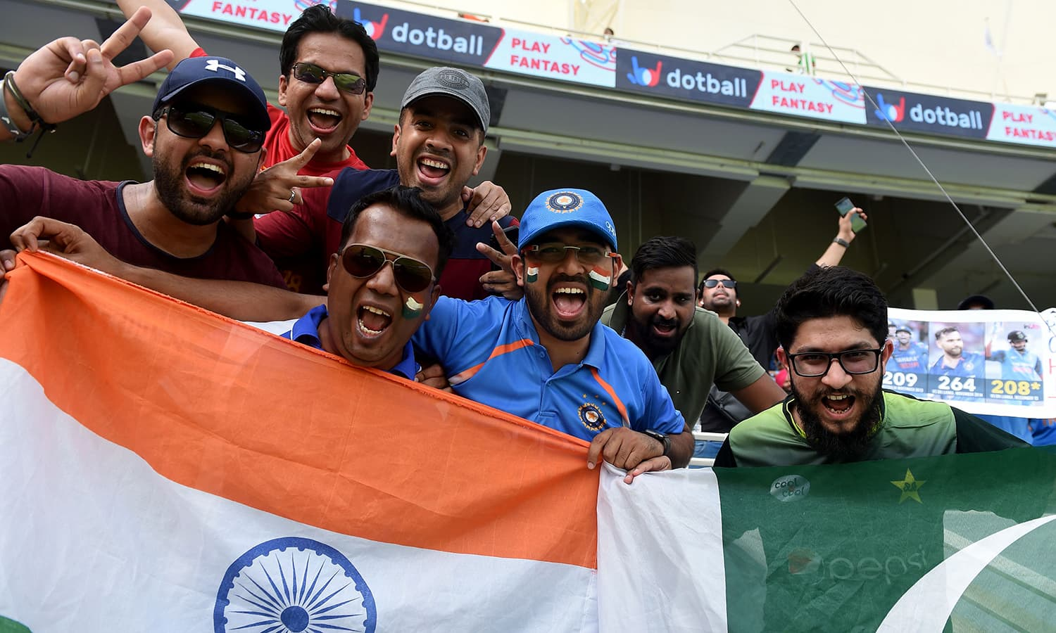 Indian and Pakistan cricket fans cheer in support of their respective national teams. —AFP