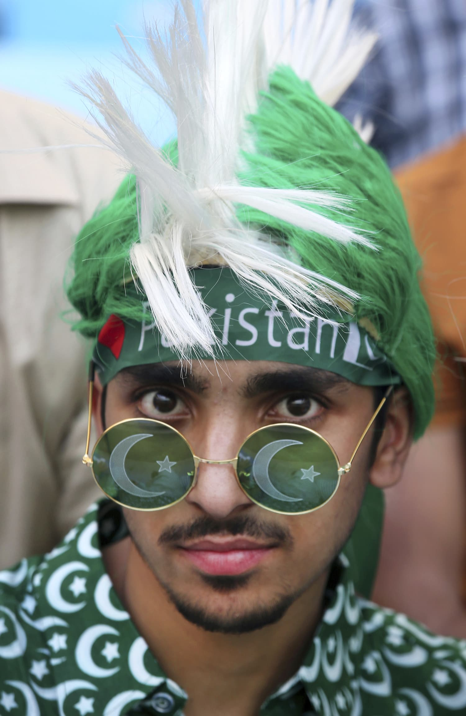 A Pakistani supporter sports a headgear and sunglasses as he waits for the start of the match. —AP.