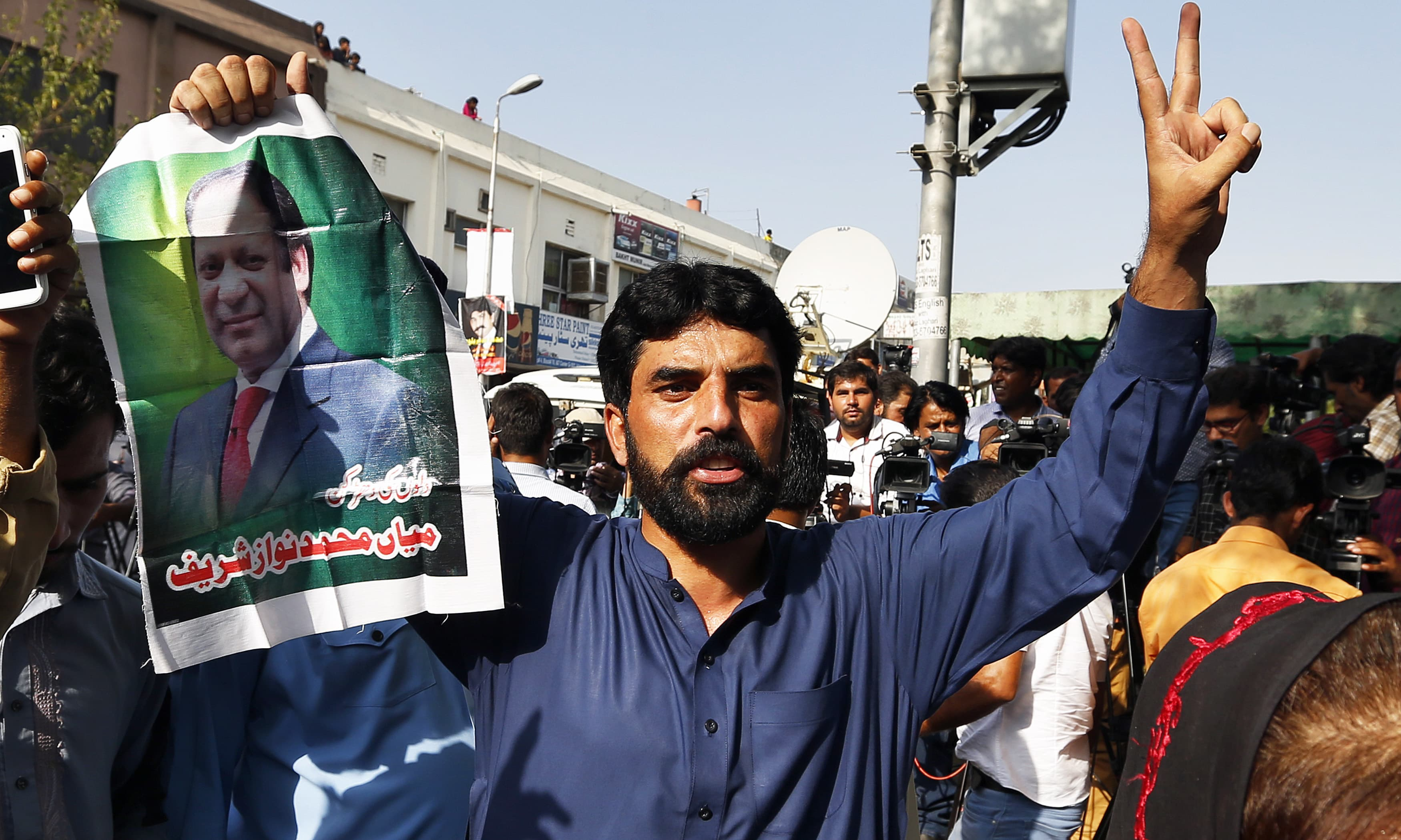 A PML-N supporter celebrates following the court ruling. —AP