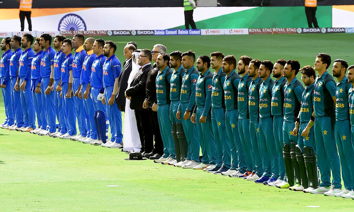Indian and Pakistani players line up for the national anthem just before the start of the ODI Asia Cup cricket match between Pakistan and India at the Dubai International Cricket Stadium. —AFP