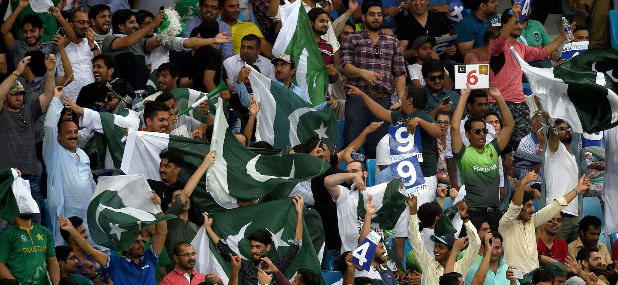 Pakistan cricket fan cheer in support of their national team during the one day international (ODI) Asia Cup cricket match between Pakistan and India at the Dubai International Cricket Stadium in Dubai on September 19, 2018. (Photo by ISHARA S. KODIKARA / AFP) — AFP or licensors