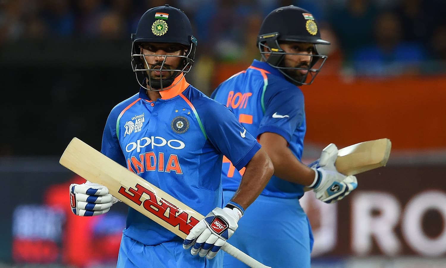 Indian cricket team captain Rohit Sharma (R) and Shikhar Dhawan runs between the wickets. —AFP