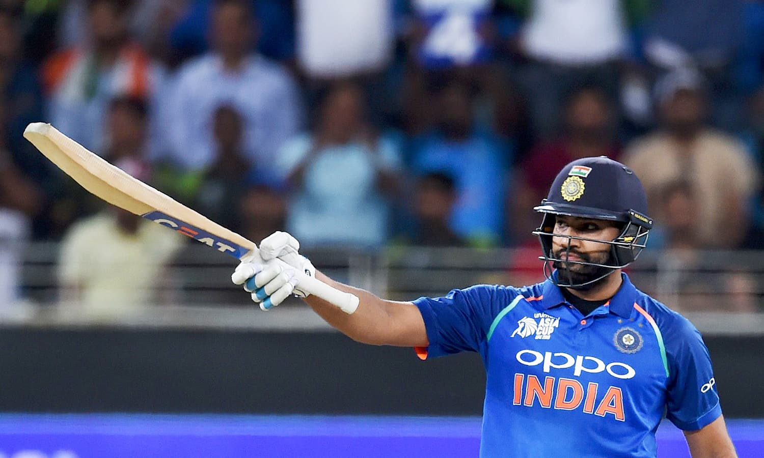 Indian cricket team captain Rohit Sharma celebrates after scoring a half-century (50 runs). —AFP