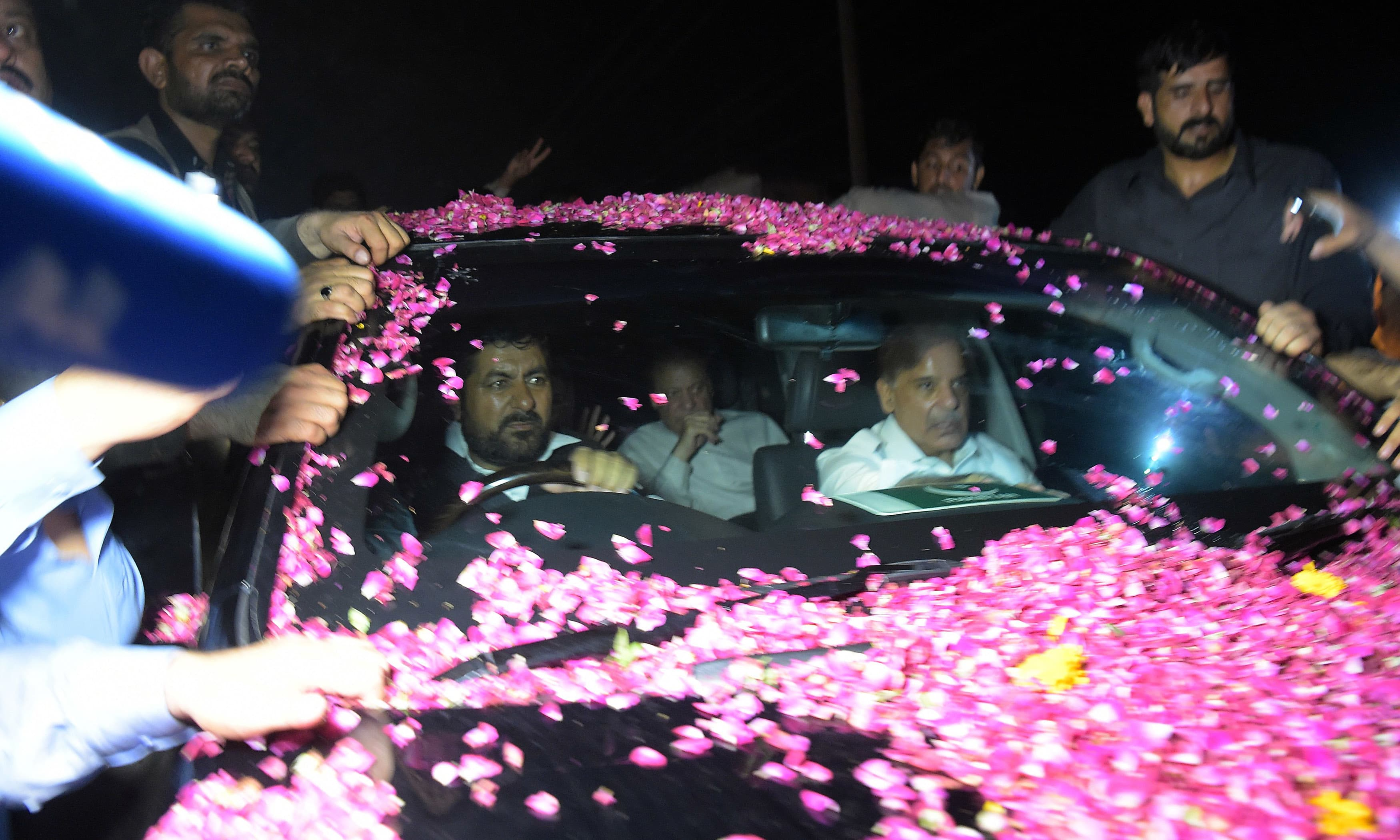Nawaz Sharif sits in a vehicle alongside Shahbaz Sharif after his release from Adiala jail. —AFP