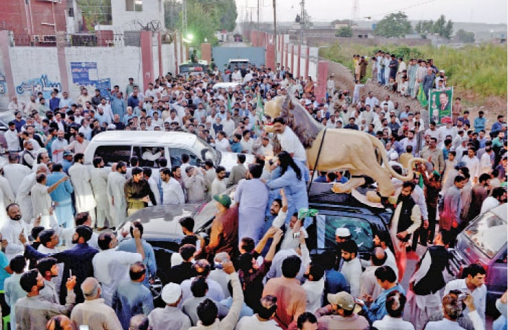 PML-N workers gather outside Adiala jail to greet Nawaz Sharif on Wednesday. — Photo by Mohammad Asim