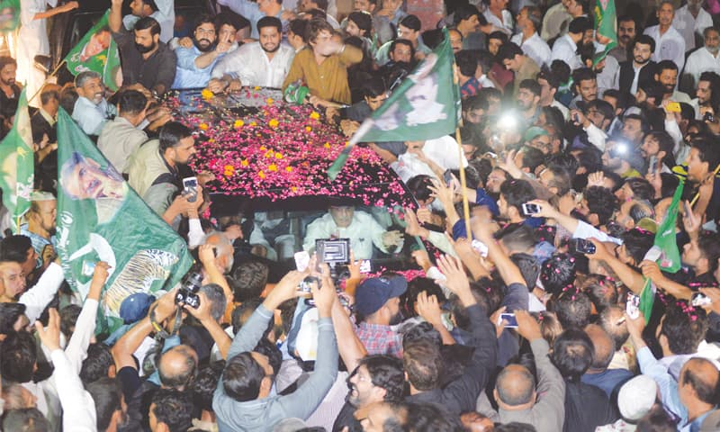 RAWALPINDI: Jubilant Pakistan Muslim League-Nawaz workers shower rose petals on the vehicle of Shahbaz Sharif after Nawaz Sharif and Maryam Nawaz were released from Adiala jail on Wednesday.—Mohammad Asim / White Star
