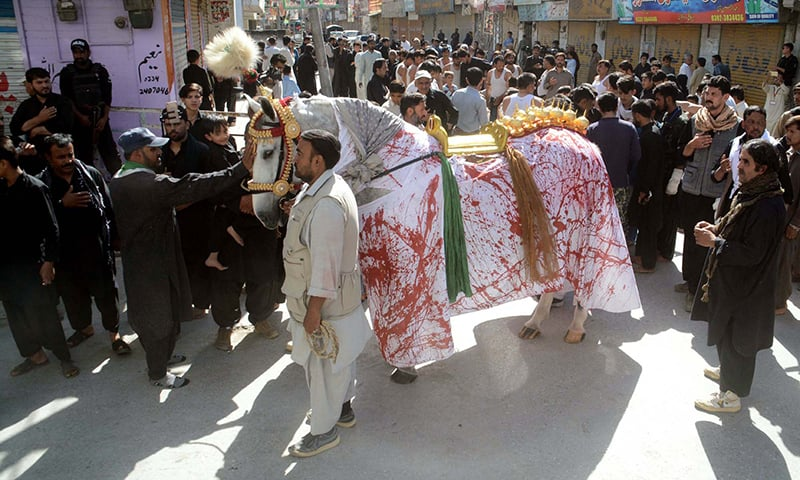 Mourning procession with Zuljana passing through a road in Quetta. —APP