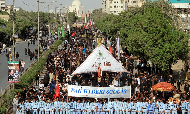 Scouts posted along procession route in Karachi. —APP