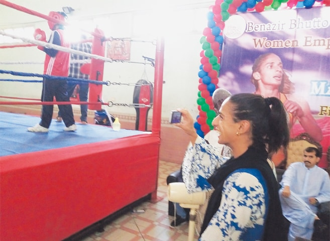 MADIEA Ghafoor enjoys a girls boxing match at the Benazir Bhutto Shaheed University, Lyari.—Photo by writer