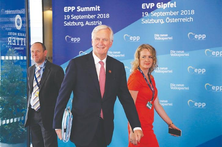 SALZBURG: EU chief Brexit negotiator Michel Barnier, centre, arrives at the informal EU summit on Wednesday.—AP