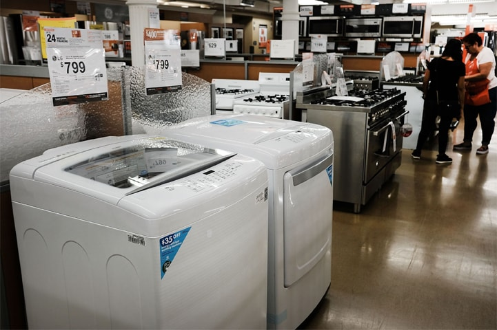 NEW YORK: Washing machines and dryers stand in a Manhattan appliance store on Thursday. As President Donald Trump continues to ratchet up the trade war with China, items such as washing machines and other household appliances that are overwhelmingly produced in China could see huge mark-ups in price.—AFP