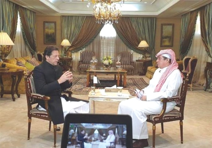 PRIME Minister Imran Khan speaks to Al Arabiya's general manager Turki al-Dakhil during the interview.—Courtesy AL ARABIYA