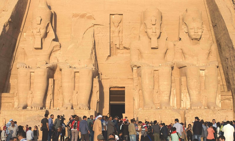 In this Oct 22, 2016, file photo tourists gather outside the temple of Abu Simbel, south of Aswan in upper Egypt, to witness the sun illuminate the inner sanctuary.—AFP