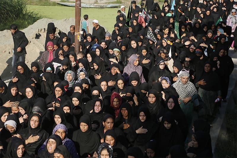 Kashmiri Shia women participate in a Muharram procession in Srinagar, IHK, on Sept 20. ? AP