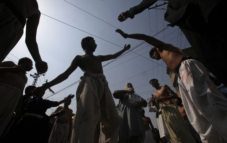 Mourners attend a Muharram procession in Peshawar. —AP