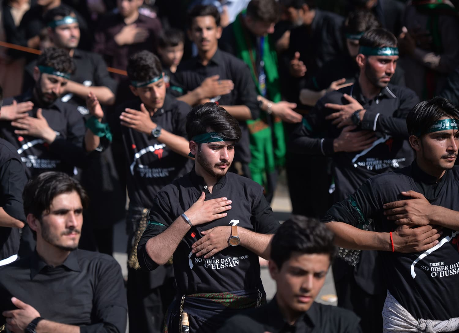 Mourners participate in 'matam' during a procession in Islamabad. — AFP