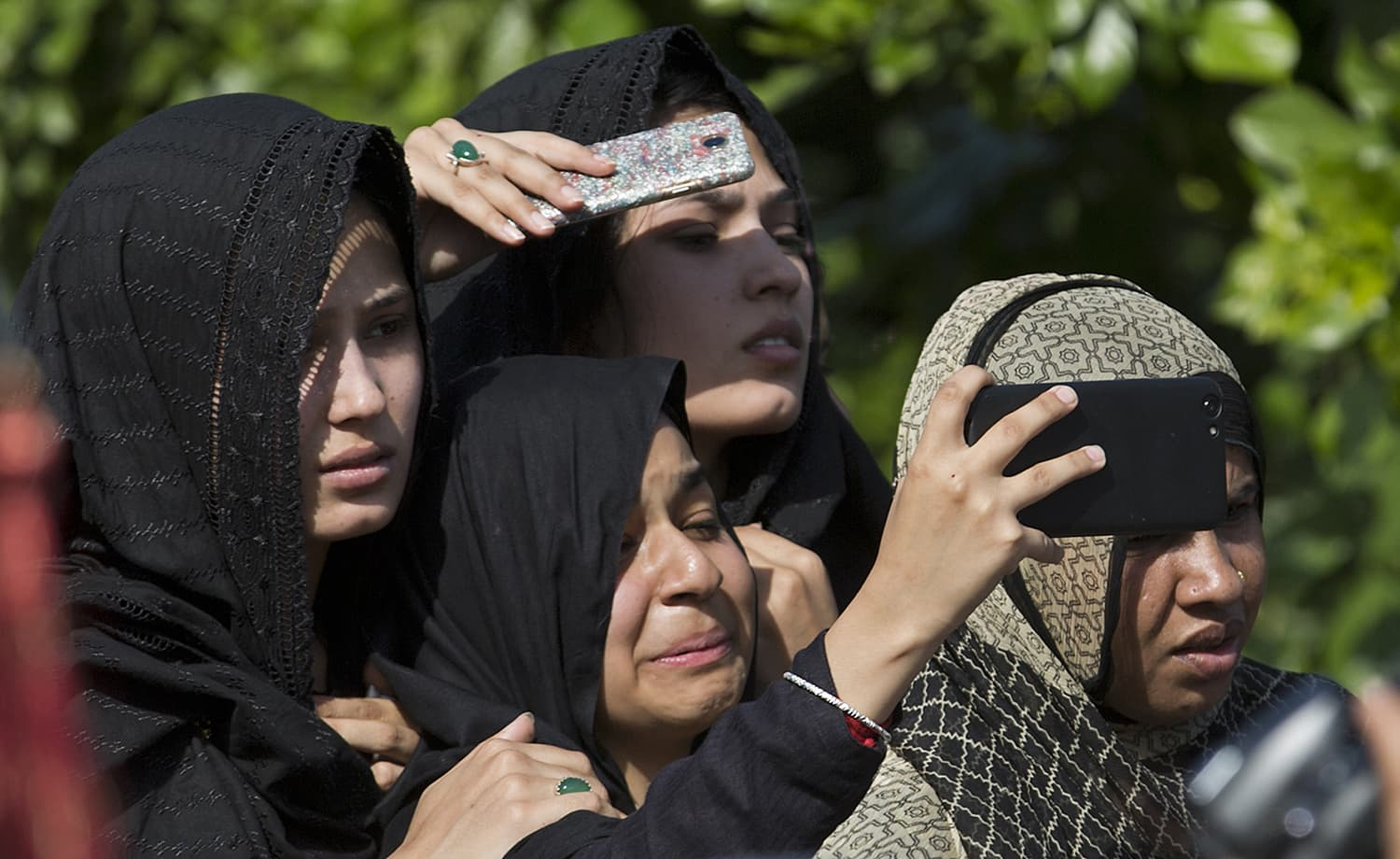 Mourners attend a procession in Islamabad. —AP