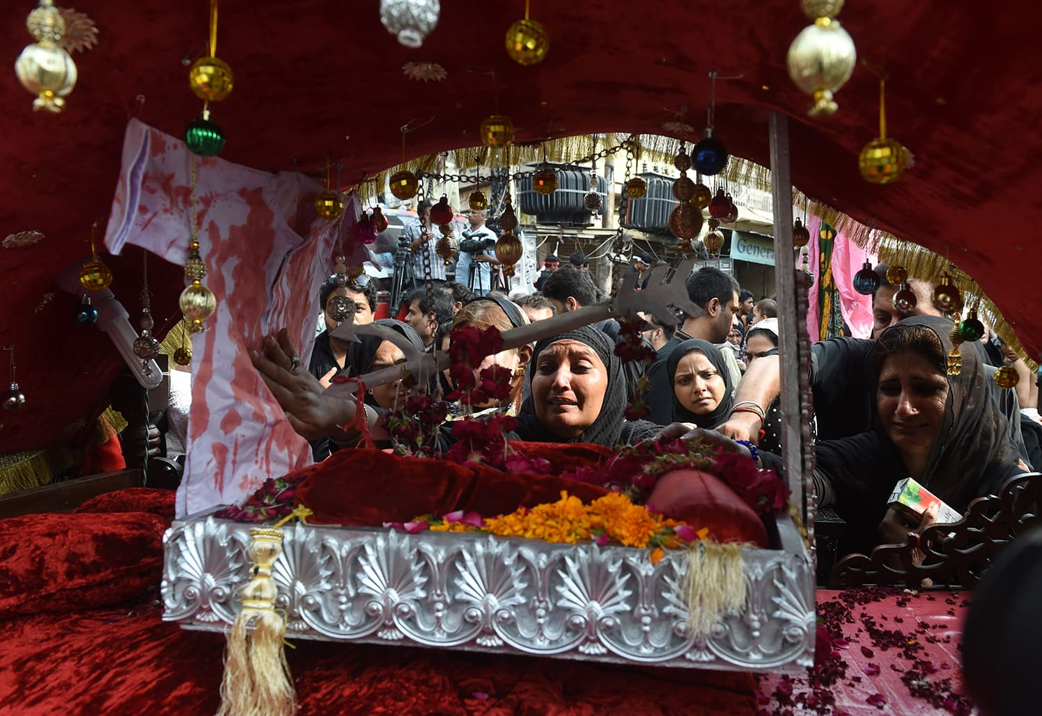 Mourners participate in a parade during a religious procession in Lahore. —AFP
