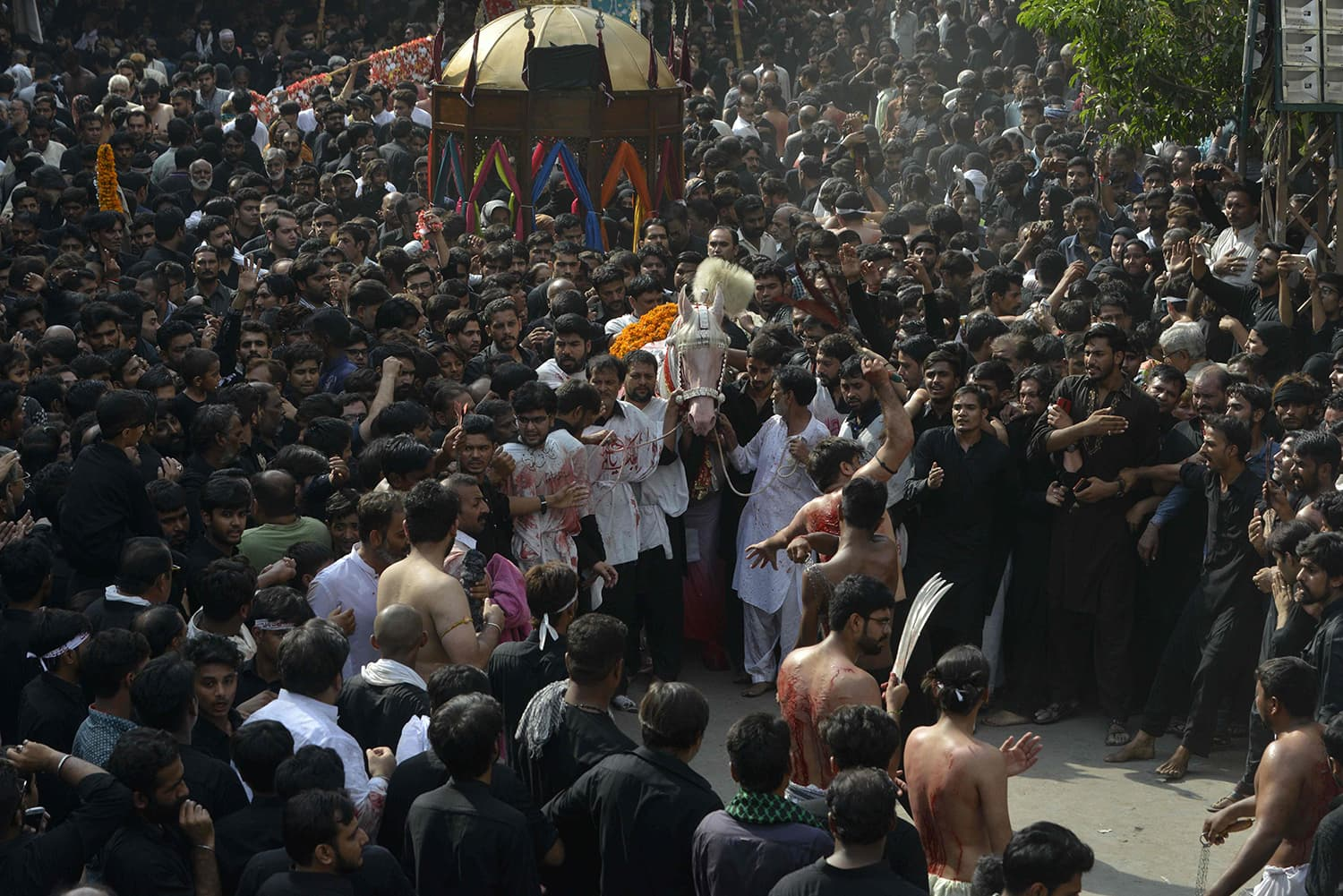 Mourners parade during a Muharram procession in Lahore. — AFP