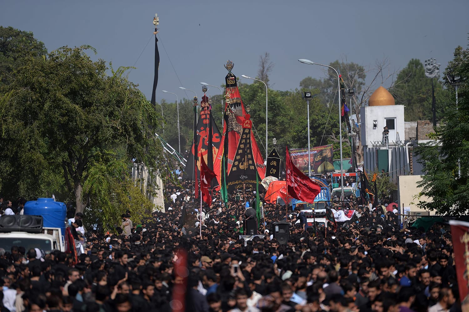Mourners during a procession in Islamabad. — AFP