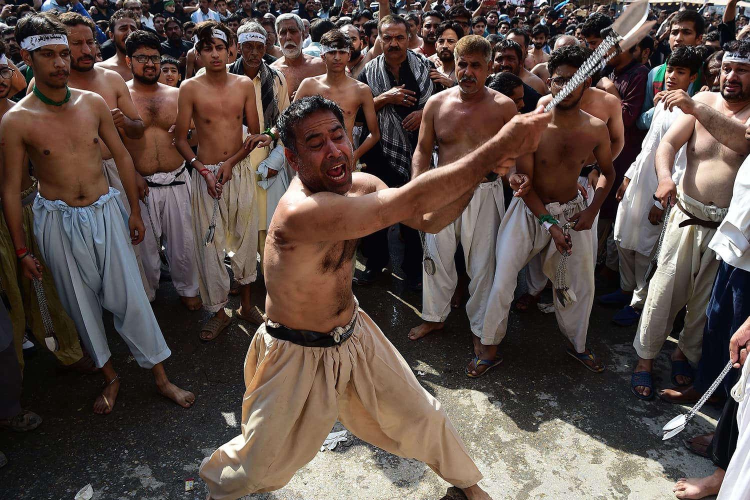A mourner takes part in 'matam' during a procession in Peshawar. —AFP