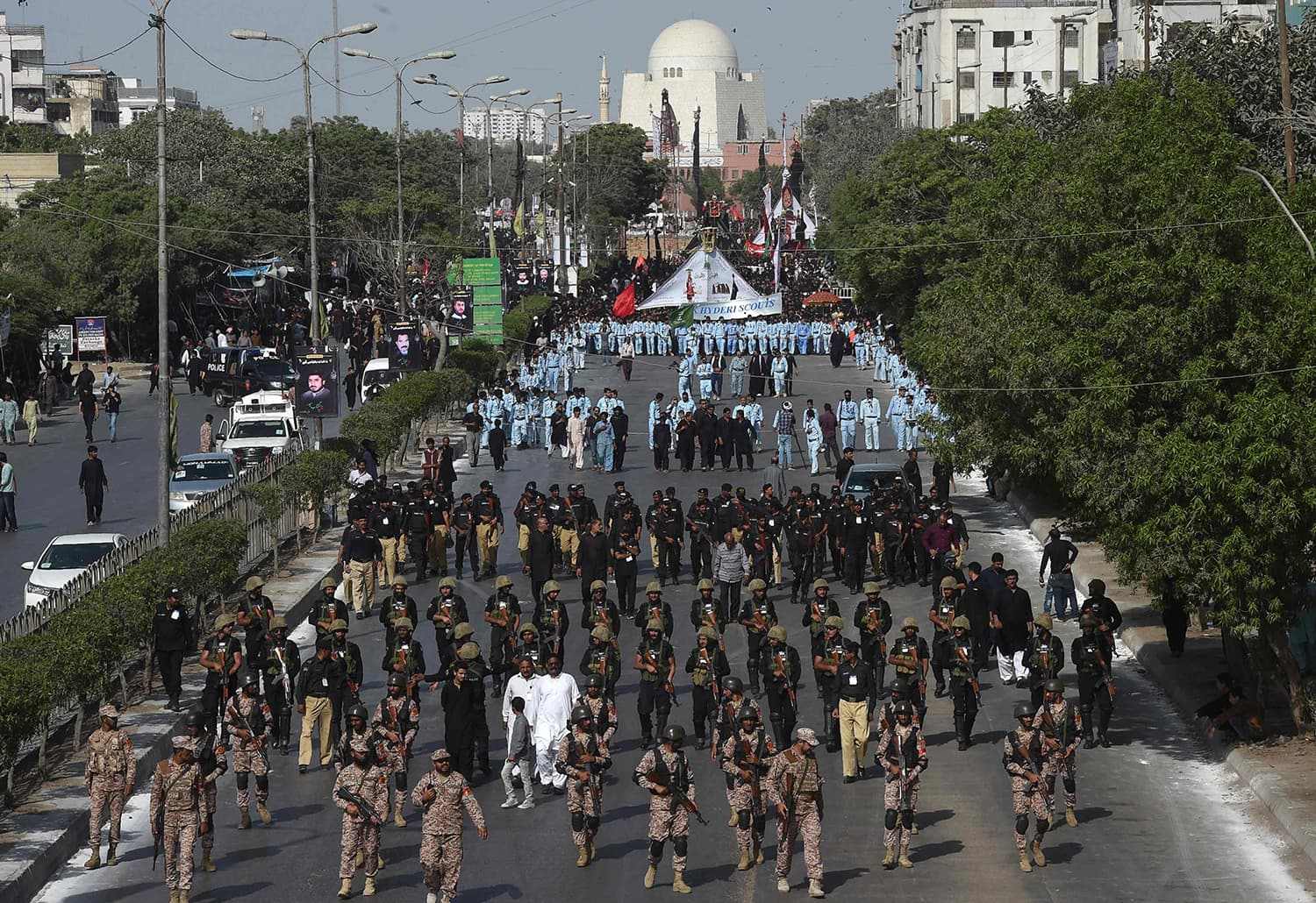 Security personnel patrol during a religious procession in Karachi. —AFP