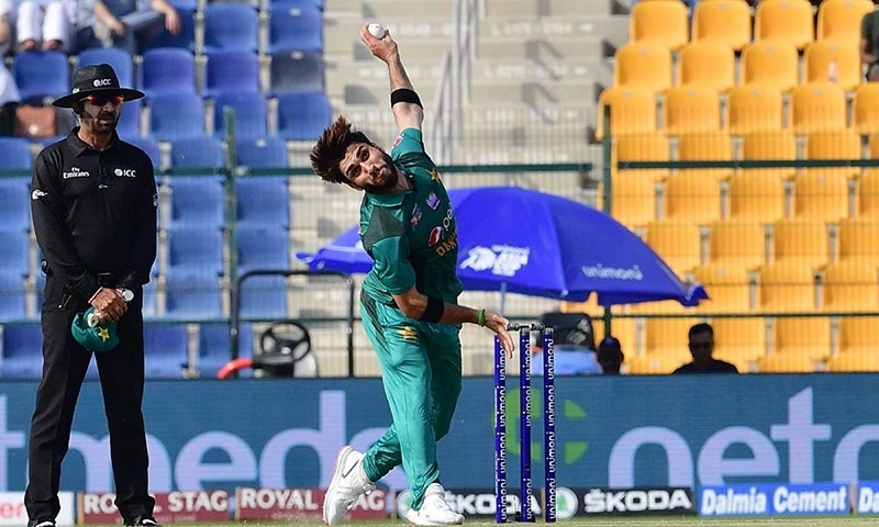 Usman Khan Shinwari bowls during  the Asia Cup cricket match between Pakistan and Afghanistan — AFP