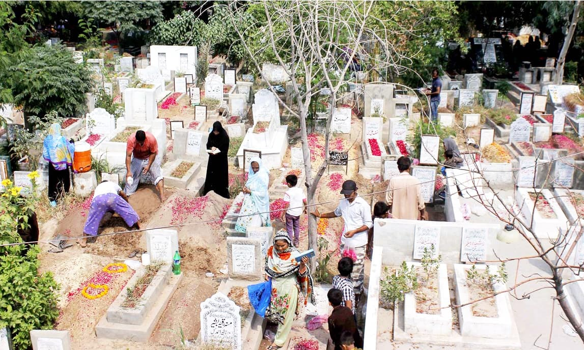 People busy in repairing graves of their loved one at the graveyard in Lahore. —APP
