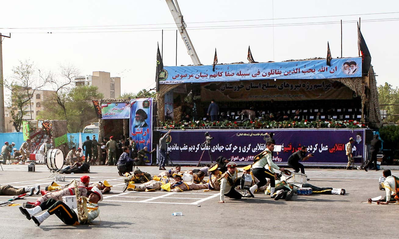 Injured soldiers lying on the ground at the scene of an attack on a military parade that was marking the anniversary of the outbreak of its devastating 1980-1988 war with Saddam Hussein's Iraq. —AFP