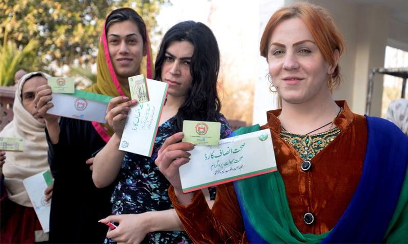 Transgender community members show their health cards at a ceremony at Peshawar Press Club | Shahbaz Butt/White Star
