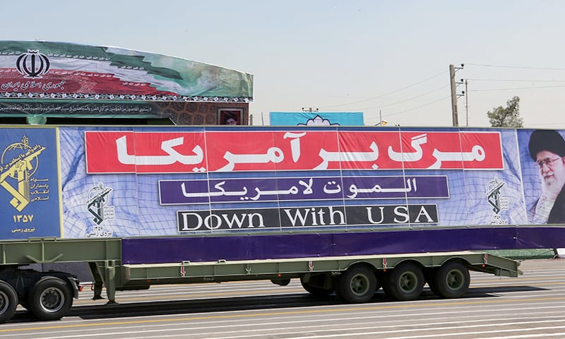 An Iranian army truck with an anti-America slogan leads military vehicles during the annual military parade in 2015. AFP