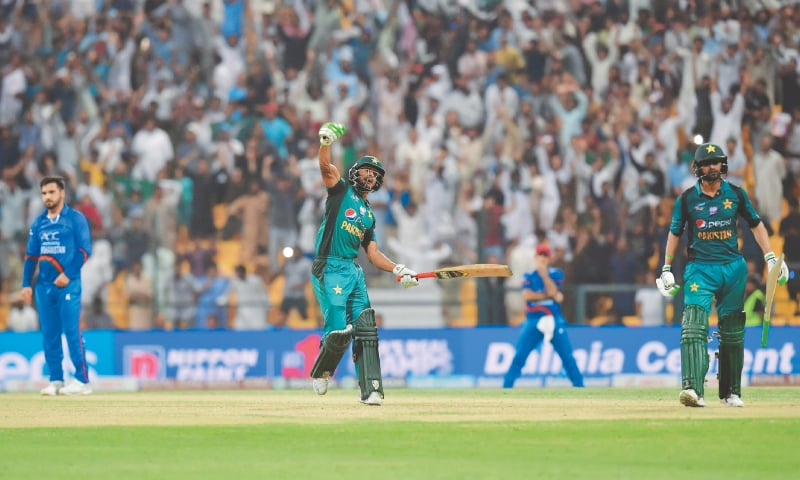 ABU DHABI: Hasan Ali (C) celebrates after Pakistan's saviour Shoaib Malik (R) struck the winning boundary at the end of the Asia Cup's Super Four match while Afghanistan paceman Aftab Alam looks crestfallen at the Sheikh Zayed Stadium on Friday night.—AFP