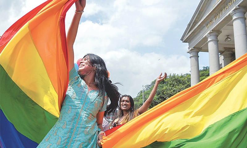 Above and below: Activists and supporters celebrate the Supreme Court decision to decriminalise same-sex relations | AFP