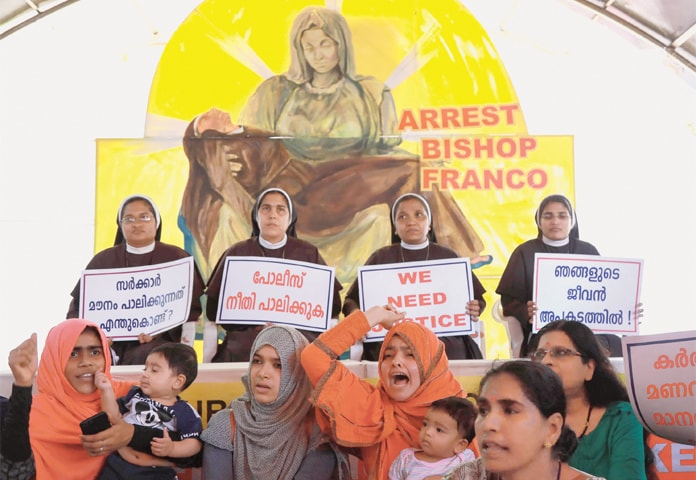 KOCHI (Kerala): Indian Christian nuns and Muslim supporters protest as they demand the arrest of Bishop Franco Mulakkal, who is accused of raping a nun, outside a high court.—AFP