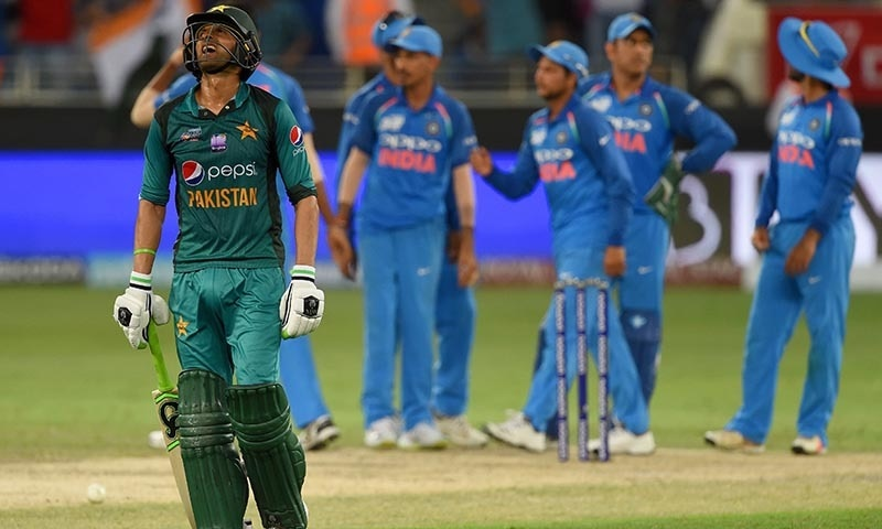 Shoaib Malik (L) reacts as he leaves the field after being dismissed — AFP