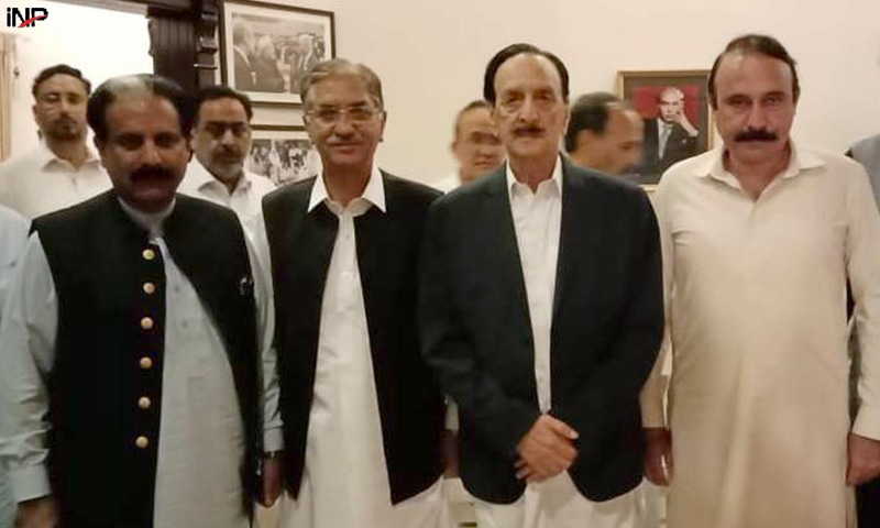 ISLAMABAD: Raja Zafarul Haq and other leaders of the Pakistan Muslim League-Nawaz, who called on Pakistan Peoples Party secretary general Nayyar Bokhari at his residence, pictured with him on Sunday.—INP