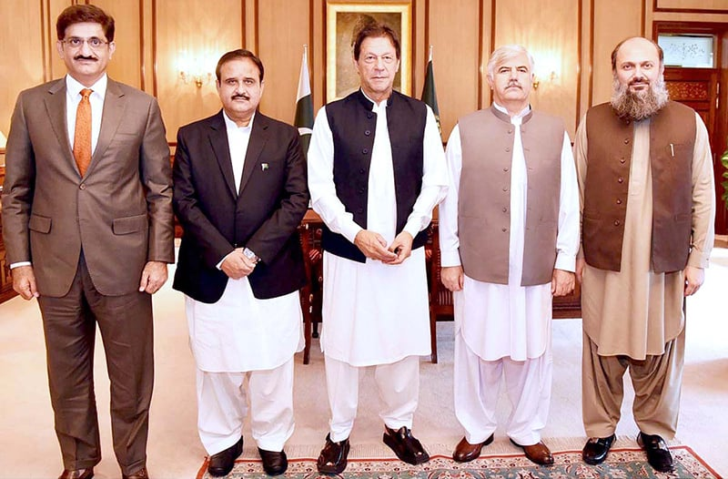 PM Imran Khan in a group photo with CM Sindh Syed Murad Ali Shah, CM Punjab Usman Buzdar, CM KP Mehmood Khan and CM Balochistan Jam Kamal Khan at PM Office. — APP