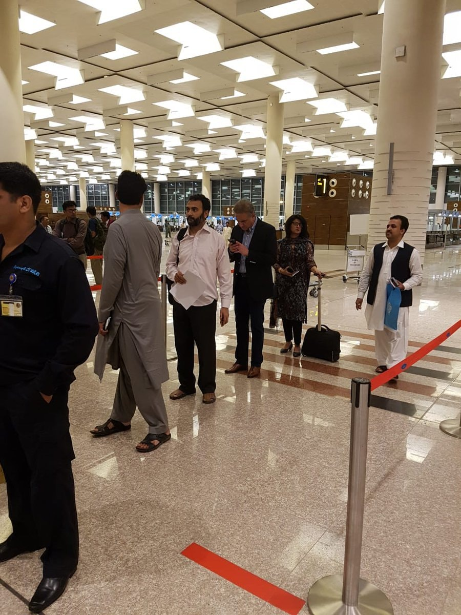 Foreign Minister Shah Mahmood Qureshi stands in line at Islamabad airport. The picture is being celebrated in PTI circles as it shows the minister standing without a VIP protocol at the airport as he prepares to leave for the United States.