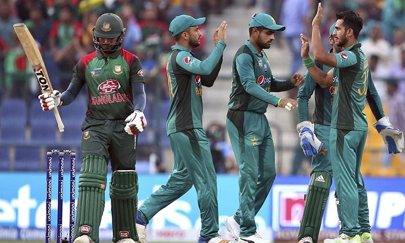 Hasan Ali, right, celebrates with teammates the dismissal of Bangladesh's Mohammad Mithun — AP