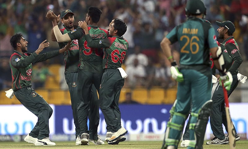 Bangladeshi players celebrate the dismissal of Pakistan's Babar Azam — AP