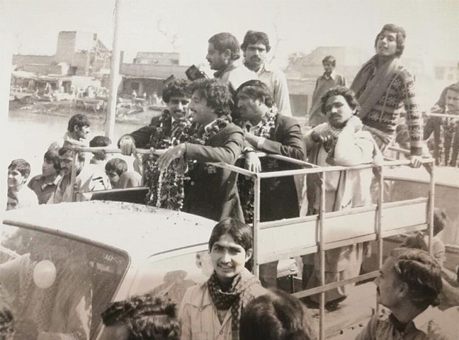 The 1982 Hockey World Cup victory parade at Gojra with team players incuding Rasheedul Hassan on the truck