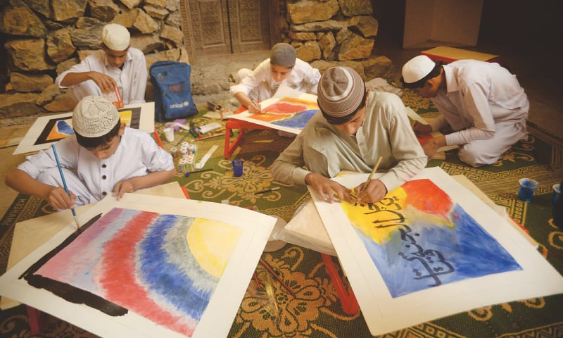 Students of a religious seminary take part in a calligraphy contest organised by the Peace Education and Development Foundation in collaboration with Unicef at Nishtar Hall,  Peshawar | Shahbaz Butt/White Star